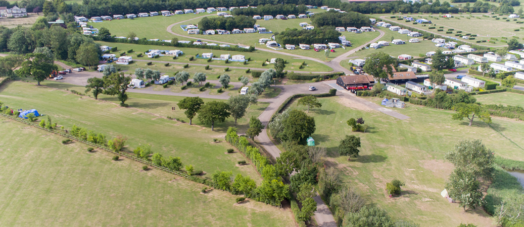 Aerial view of camping and touring pitches at Waldegraves Holiday Park in Essex